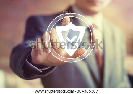 Businessman hand press shield security virus web button icon - stock photo
