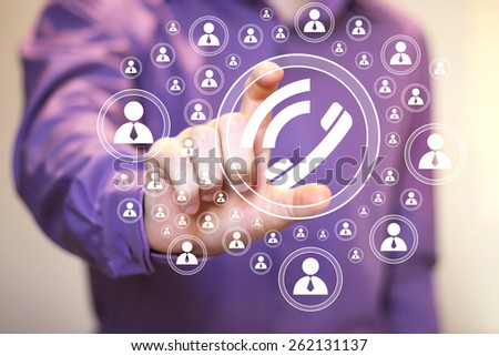 Businessman hand press telephone button - stock photo