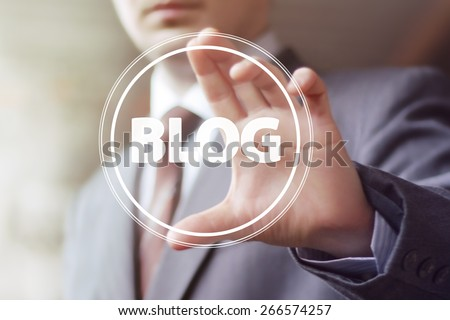 Businessman hand press web blog button sign - stock photo
