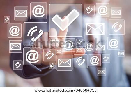 Businessman hand press web button checked mark icon - stock photo