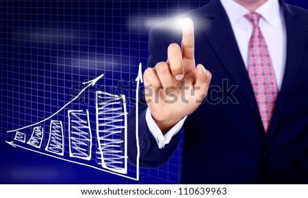 Businessman hand pressing a chart - stock photo
