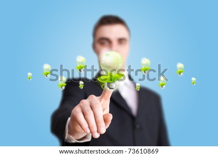 Businessman hand pressing eco bulp button - stock photo