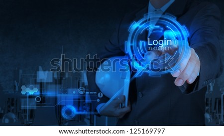 businessman hand pressing login button on touch screen computer screen - stock photo