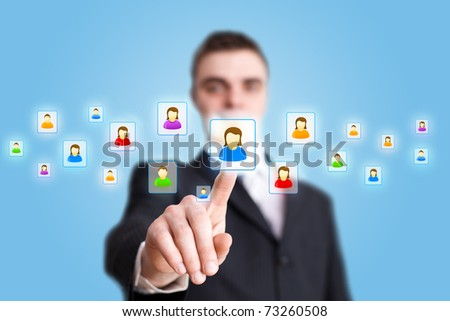 Businessman hand pressing Social network icon - stock photo