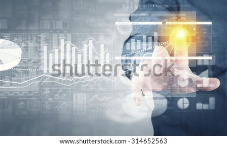 Businessman hand pushing business graph on touch screen interface - stock photo