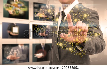 businessman hand pushing button on a touch screen interface - stock photo