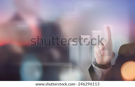 Businessman hand pushing button on touch screen interface graphic - stock photo