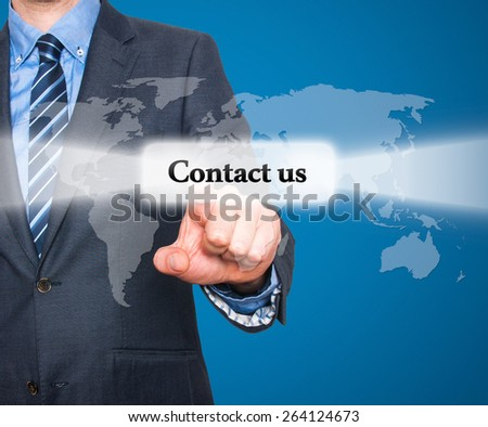 businessman hand pushing contact us button on a touch screen interface. Isolated on blue background. Stock Photo - stock photo
