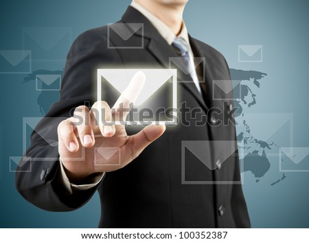 businessman hand pushing mail sign - stock photo