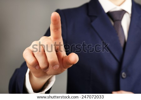 Businessman hand pushing screen, close-up - stock photo