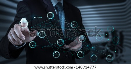 businessman hand pushing solution diagram on a touch screen interface as concept - stock photo