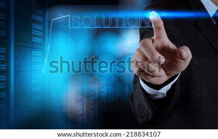 businessman hand pushing solution graph on a touch screen interface  - stock photo
