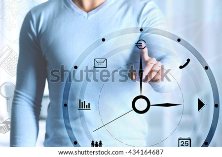 Businessman hand pushing time icon on virtual screen. - stock photo