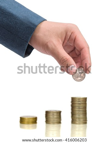 Businessman Hand Put Coin To Stack Of Coins, white background - stock photo