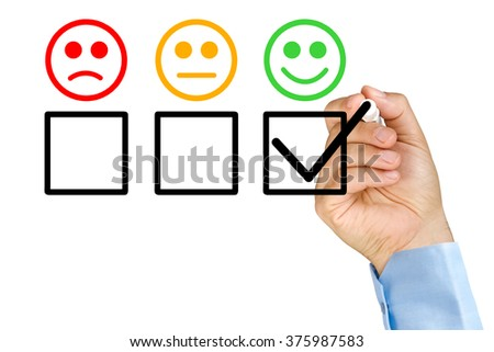 Businessman hand putting check mark with marker on customer service evaluation form on clear glass whiteboard isolated - stock photo