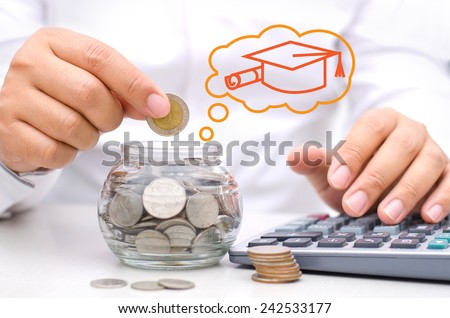 businessman hand putting money coins into glass piggy bank for Education - stock photo