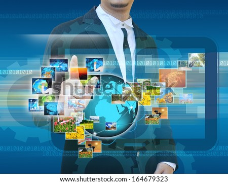 businessman hand  Reaching images streaming in hands .Financial and technologies concepts - stock photo