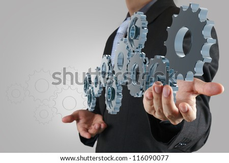 businessman hand show blue gear to success as concept - stock photo