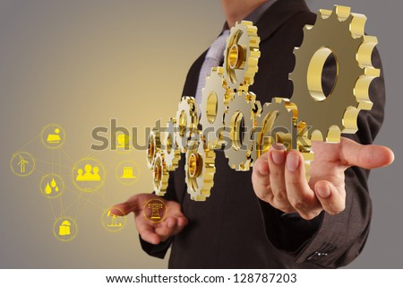 businessman hand show 3d golden gear to success as industry concept - stock photo