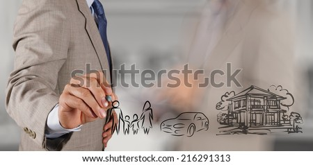 businessman hand show planning family future on screen background as concept  - stock photo