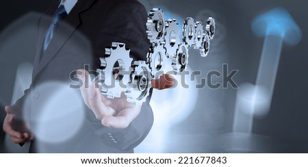 businessman hand showing 3d gear to success concept  - stock photo