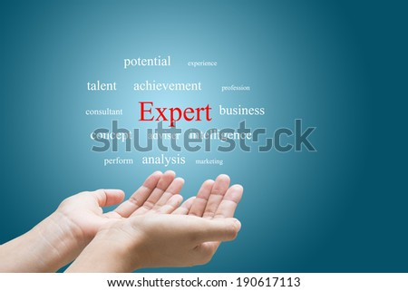 Businessman Hand Showing expert Word - stock photo