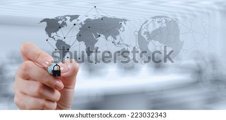 businessman hand showing padlock on touch screen computer as Internet security online business concept  - stock photo