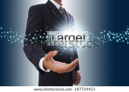 Businessman hand showing target button on virtual screen.  - stock photo