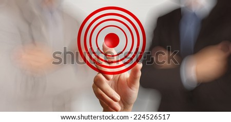 businessman hand shows target symbol as business concept  - stock photo