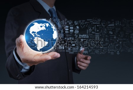 businessman hand the world and business strategy as concept - stock photo