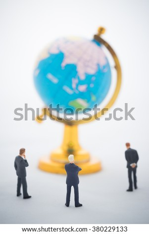 Businessman hand thinking or making decision in front of the global, Global business concept. - stock photo
