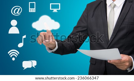 Businessman hand touch cloud computing concept on blue background - stock photo