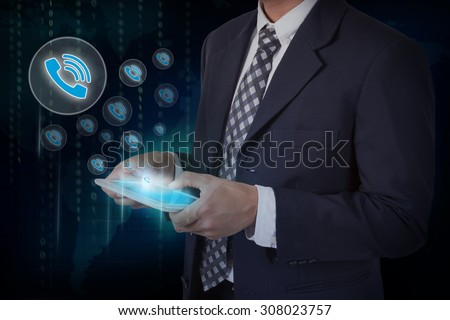 Businessman hand touch screen  telephone sign icons on a tablet. - stock photo