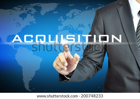 Businessman hand touching ACQUISITION word on virtual screen - business abstract - stock photo