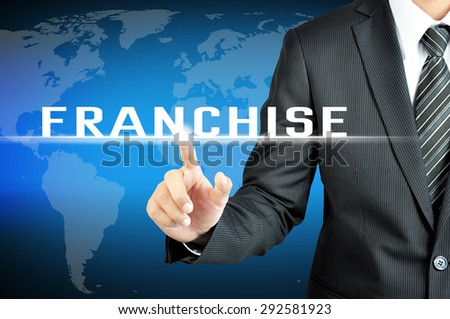 Businessman hand touching FRANCHISE sign on virtual screeen - stock photo