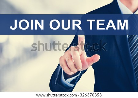 Businessman hand touching JOIN OUR TEAM message on virtual screen - stock photo