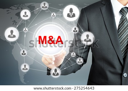 Businessman hand touching M&A (Merger and Acquisition) sign  on virtual screen - stock photo