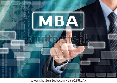 Businessman hand touching MBA (or Master of Business Administration ) sign on virtual screen - stock photo