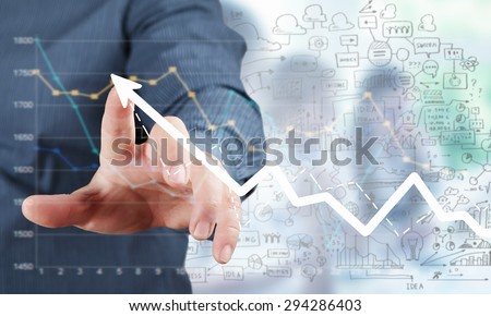 Businessman hand touching virtual graph on media screen - stock photo