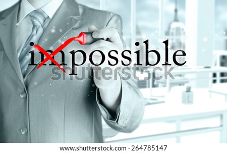 Businessman Hand turning the word Impossible into Possible with red marker  - stock photo