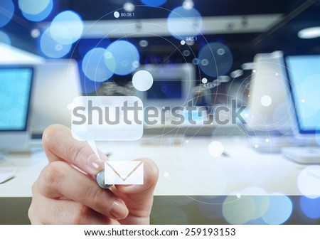 businessman hand use interactive computer with virtual email icon as concept - stock photo