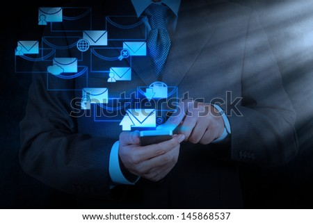 businessman hand use smart phone computer with modern email icon - stock photo