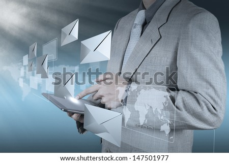 businessman hand use tablet computer with email icon - stock photo