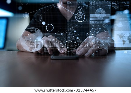 Businessman hand using mobile phone with digital layer effect as business strategy concept                  - stock photo