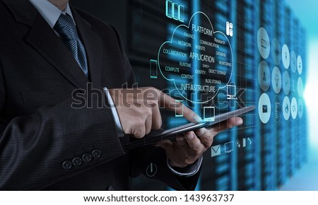 businessman hand using tablet computer and server room background - stock photo