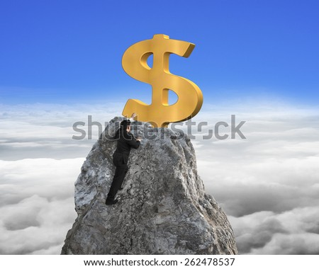 Businessman hand wanting for gold dollar sign on mountain peak with blue sky cloudscape background - stock photo