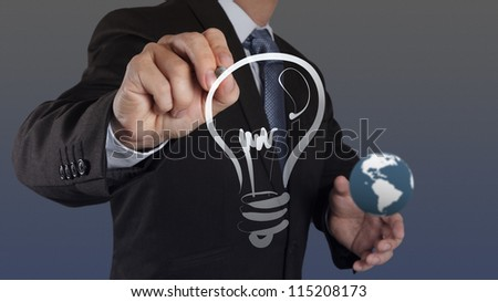 businessman hand with a pen drawing light bulb - stock photo