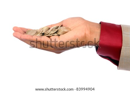 Businessman hand with Indian rupee coins. - stock photo