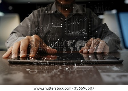 businessman hand working on laptop computer with digital layer business strategy and social media diagram on wooden desk - stock photo