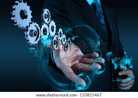 businessman hand working with cog gear to success as concept - stock photo